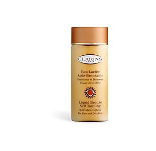 Молочко-автозагар для лица и зоны декольте Eau Lactée Auto-bronzante Visage et Décolleté от Clarins (1)